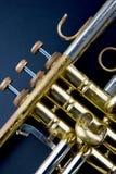 Vintage Trumpet. Brass music instrument - part of vintage golden trumpet on black background Stock Photography