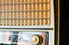 Vintage Tube radio from aside. Grill-cloth and knob of a vintage tube radio shoot from one side Stock Image