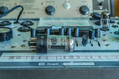 Vintage tube tester. Old vintage tube tester that tested tubes for televisions and radios back in the day. An old tube sitting on top of the tester royalty free stock photos