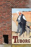 Vintage Tuborg beer advertising on a wall. Middelfart, Denmark - September 10, 2016: Vintage Tuborg beer advertising on a wall. Tuborg is a Danish brewing Stock Photos
