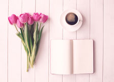 Vintage tulips and coffee cup Stock Photos