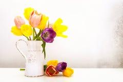 Vintage Tulips in Milk Pitcher Stock Photo