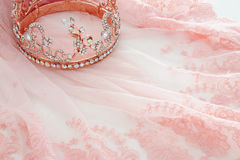 Vintage tulle pink chiffon dress and diamond tiara on wooden white table Royalty Free Stock Photo