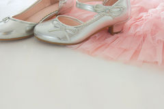 Vintage tulle pink chiffon dress and silver shoes on wooden white floor. Wedding, bridesmaid and girl& x27;s party concept. Vintage tulle pink chiffon dress Royalty Free Stock Images