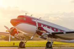 Vintage turboprop airplane at the airport at sunset Royalty Free Stock Photo