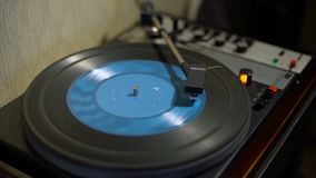 Vintage Turntable and Blue Vinyl Record. Vintage Turntable Playing Blue Vinyl Record. Camera Focus Moves from Control Box to Vynil Record and Back stock footage