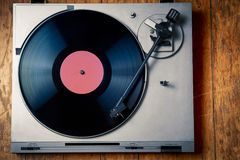 Vintage turntable with disc on wood Royalty Free Stock Photography