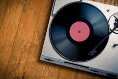 Vintage turntable with disc on wood Royalty Free Stock Image