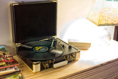 Vintage turntable. Vintage look turntable with long play on it Royalty Free Stock Photo