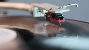 Vintage turntable operation. Front view footage on playing vinyl turntable with focus on stylus stock footage