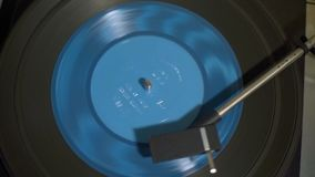 Vintage Turntable with Spining Blue Vinyl Record. Vintage Turntable Playing Blue Vinyl Record. View from Above. Close-Up Shot stock video footage