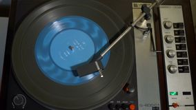 Vintage Turntable with Spining Blue Vinyl. Vintage Turntable Playing Blue Vinyl Record. View from Above stock video