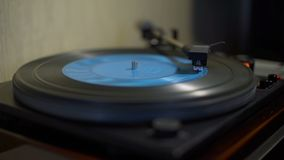 Vintage Turntable Playing Blue Vinyl Record. Close-Up Shot stock footage