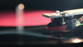 Vintage turntable playing. Footage of vintage vinyl turntable playing with focus on stylus stock video