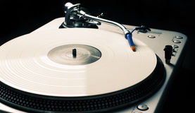Vintage turntable playing music Royalty Free Stock Image