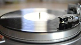 Vintage turntable playing. Vinyl record, sliding camera movement stock video