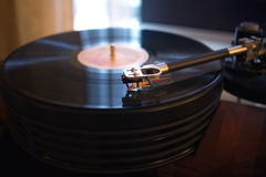 Vintage turntable playing vinyl record Royalty Free Stock Photo