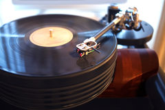 Vintage turntable playing vinyl record Royalty Free Stock Images