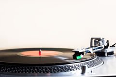 Vintage turntable. Vintage record player with a record on it Stock Photo