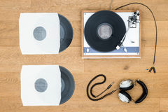 Vintage Turntable And Records On Wooden Table Stock Photo