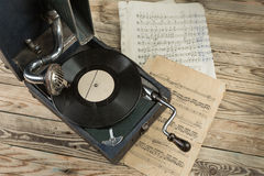 Vintage turntable vinyl record player on wooden background Royalty Free Stock Image