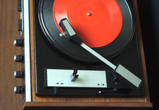 Vintage turntable with vinyl record top view closeup Royalty Free Stock Photography