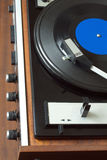 Vintage turntable with vinyl record top view closeup Royalty Free Stock Images