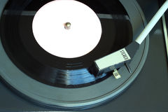 Vintage turntable with vinyl record top view closeup Stock Photo