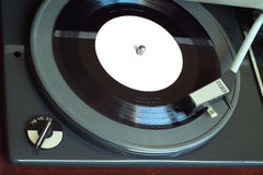 Vintage turntable with vinyl record top view closeup Royalty Free Stock Photo