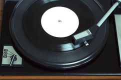 Vintage turntable with vinyl record top view closeup Stock Photography