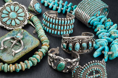 Turquoise and Silver Jewelry. A Collection of Vintage Native American Turquoise and Silver Jewelry on a black background
