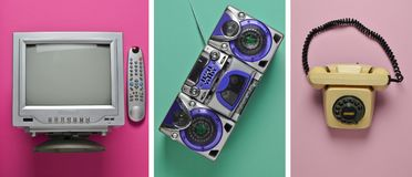 Vintage tv, audio tape recorder, rotary phone on pastel background royalty free stock photo