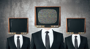 Vintage TV headed businessmen stock illustration