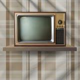 Vintage tv on shelf Royalty Free Stock Photo