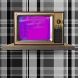 Vintage tv on shelf Stock Photos