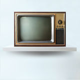 Vintage tv on shelf Royalty Free Stock Images