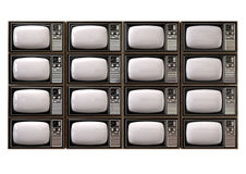 Vintage TV Stack Isolated Front. An stack of sixteen old vintage tube televisions with wood trim and chrome dials on an isolated background Stock Images