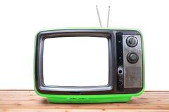 Vintage TV sur la table en bois Image stock