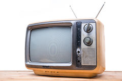 Vintage TV on wood table Royalty Free Stock Photos