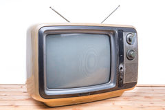 Vintage TV on wood table Royalty Free Stock Images