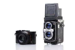 Vintage twin lens camera and a new generation compact camera Royalty Free Stock Photos