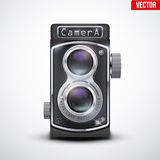 Vintage twin lens reflex camera. With closed viewfinder. Front view. Realistic retro design of medium format camera. Vector Illustration on white background royalty free illustration