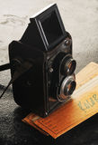 Vintage twin reflex camera. And filmstrip Royalty Free Stock Photography