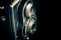 Vintage twin reflex camera isolated on black. Vintage twin reflex camera isolated on a black background Royalty Free Stock Images