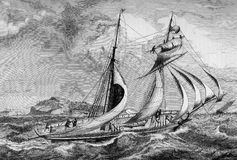 Vintage two-mast ship in the tempest. Vintage engraving, two-mast sailing ship fighting against stormy weather Royalty Free Stock Photo