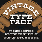 Vintage typeface. Retro distressed alphabet vector font. Slab serif letters and numbers. royalty free illustration