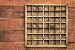 Vintage typesetter case on rustic wood Stock Photo