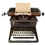 Vintage Typewriter. Vintage manual typewriter, with sheet of aged notepaper providing copy space. Isolated on white stock photo