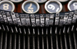Vintage Typewriter. Closeup of antique typewriter keys. Lot's of old grunge around the letter stamps Royalty Free Stock Photography