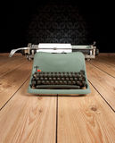 Vintage typewriter. On an ancient background Stock Photography